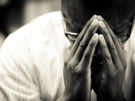 Picture of a penitent person at The Sacrament of Reconciliation
